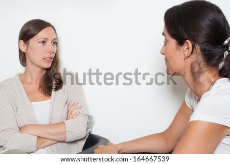 Two women talking in a room about problems - stock photo