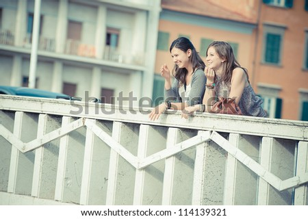 Two Women Talking in the City,Italy - stock photo