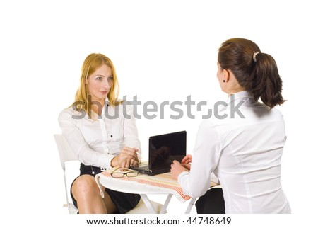 Two women talking in the office isolated over white