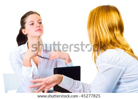 Two women talking in the office isolated over white - stock photo