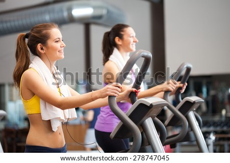 Two women training in a gym - stock photo