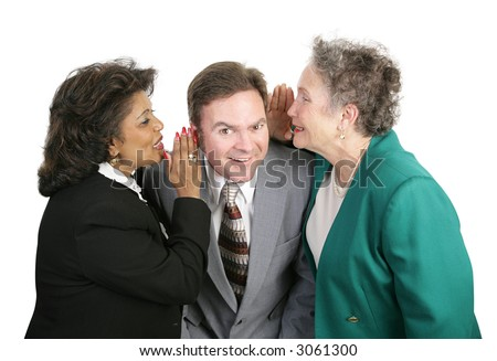 Two women whispering office gossip to a male colleague.  Isolated on white. - stock photo