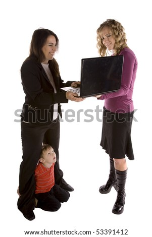 Two women with a computer.  One woman has her son. - stock photo