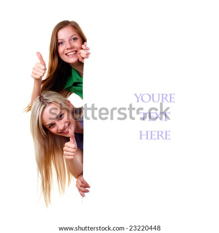 Two women with big white empty banner - stock photo