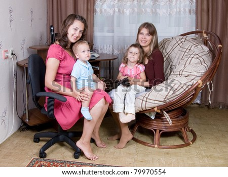 Two women with children communicate - stock photo