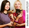 two women with dogs - stock photo