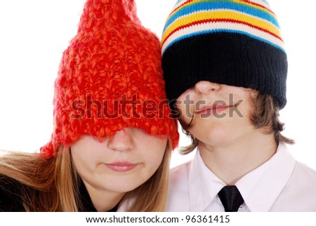 two women with knitted hats over her faces