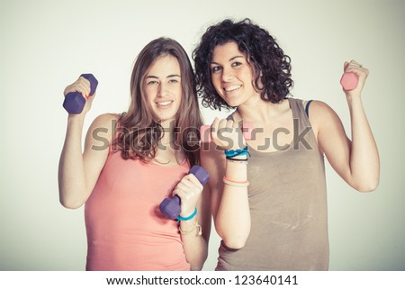 Two Women with Light Weights at Gym - stock photo