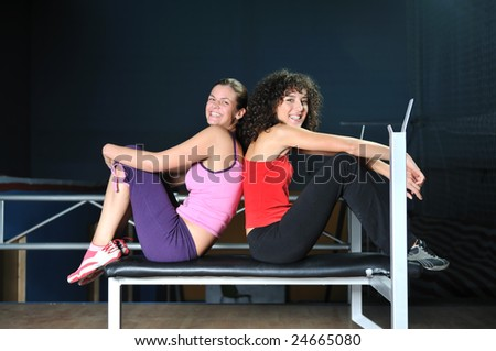 two women work out and streaching  in fitness club - stock photo
