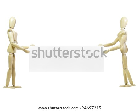 Two wood puppets holding sign isolated over white background - stock photo