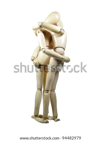 Two wood puppets kissing each other isolated over white background - stock photo