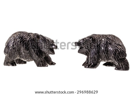 two wooden bear cub figurine isolated over a white background - stock photo