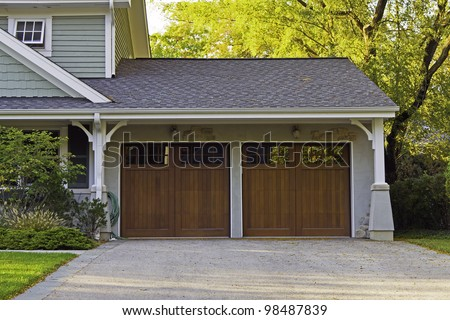 Two wooden car garage - stock photo