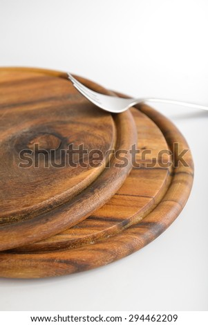 two wooden cutting boards on white background - stock photo
