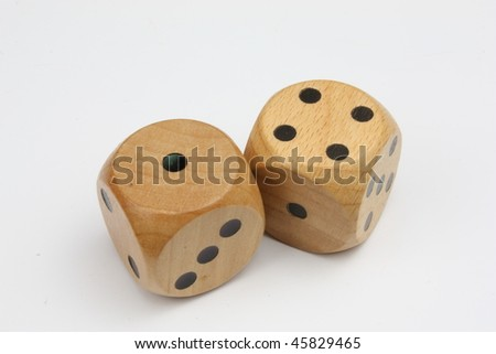 Two Wooden Dice on a white background with the number five showing.