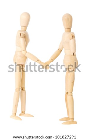 Two wooden dolls doing a handshake over a white background - stock photo