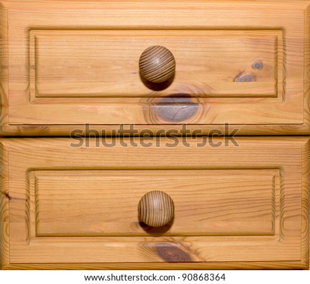 Two wooden drawers with knobs - stock photo