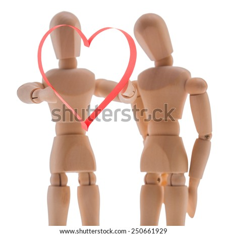 two wooden figure dummy mannequin, give romantic gift a big red heart, made of paper tape in the shape of heart isolated on a white background - pictures concept theme Love and St. Valentine's Day - stock photo