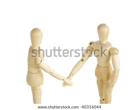 Two wooden figures shaking hands. - stock photo
