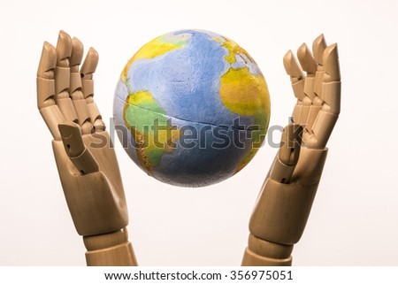 Two wooden frames hands and protects the world on white background