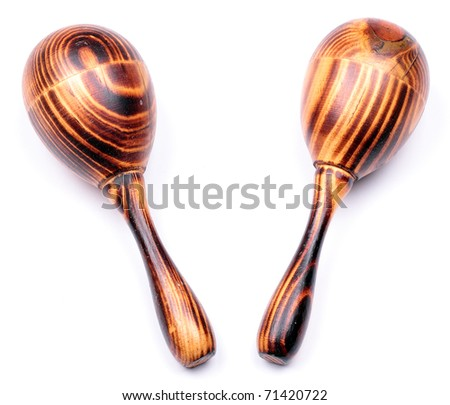 Two wooden maracas with a typical wood structure isolated on white background - stock photo