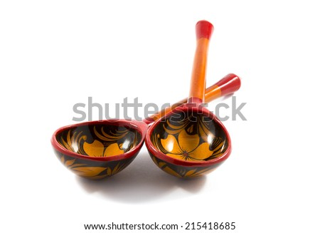 Two wooden Russian tableware spoon, embellished by hand paints on a white background