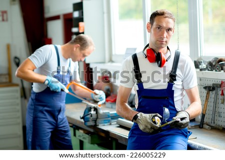 two worker on work bench - stock photo