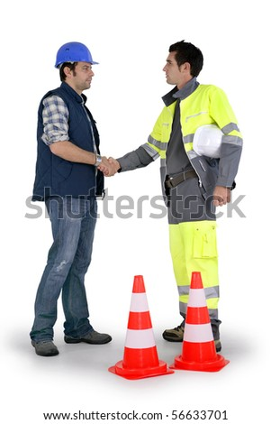Two workers handshaking on white background - stock photo