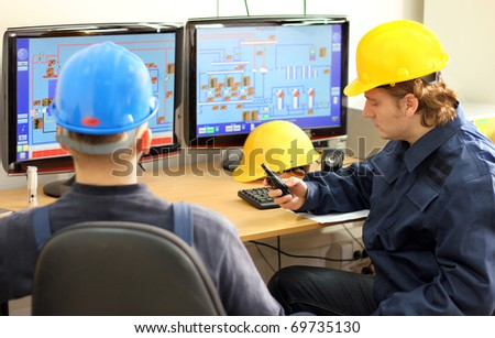Two Workers in Control Room - stock photo