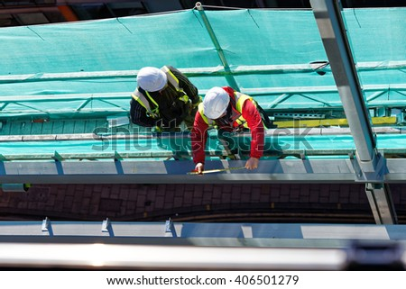 two workers on construction site