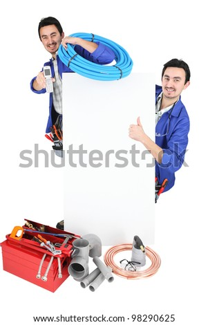 Two workers stood with blank poster - stock photo