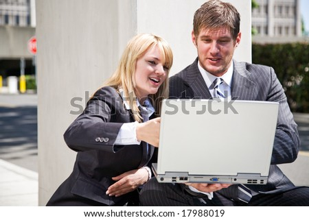 Two working caucasian business people having a discussion