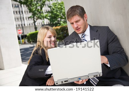 Two working caucasian business people having a discussion - stock photo