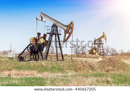 two working oil pumps on the petroleum field