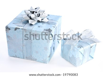 Two wrapped christmas gift boxes isolated on white background - stock photo
