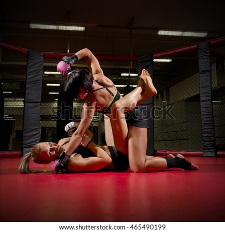 Two wrestler women in sports hall
