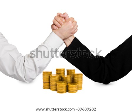 Two wrestling hands and coins isolated on white background - stock photo