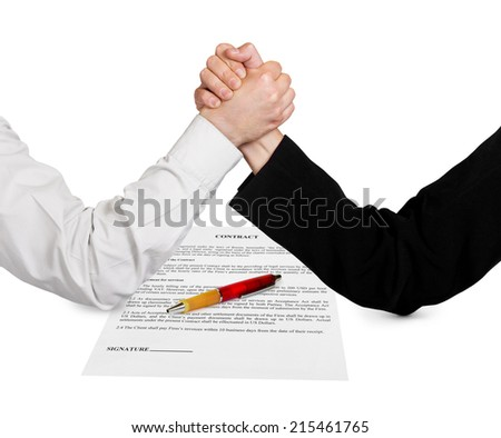 Two wrestling hands and contract isolated on white background - stock photo