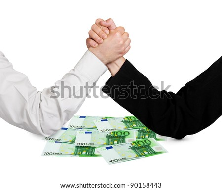 Two wrestling hands and money euro isolated on white background - stock photo