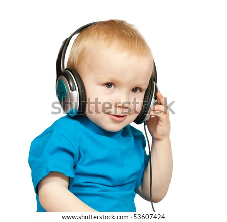 two-year boy in  blue shirt with headphones, isolated on white - stock photo
