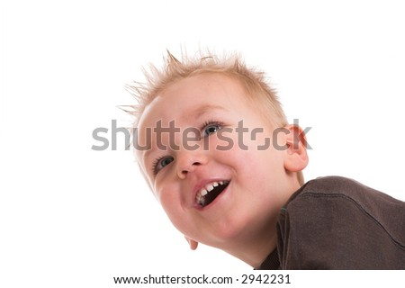Two year old boy looking up with a big smile