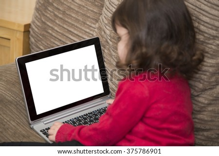 Two year old looking at Laptop - stock photo