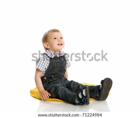 Two years boy sitting on floor isolated on white - stock photo