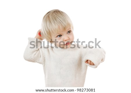 two years old blond boy in white sweater on white background - stock photo