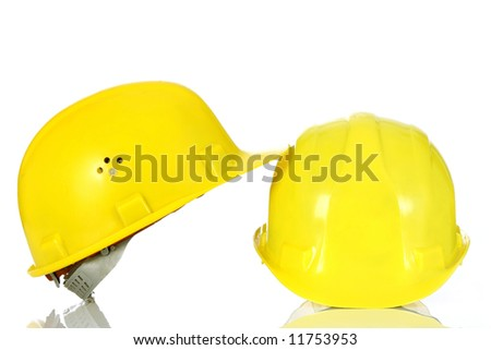 two yellow helmet on white background