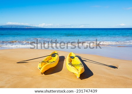 Two Yellow Ocean Kayaks on Sunny Tropical Beach  - stock photo