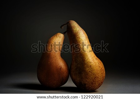 two yellow pear on a black background - stock photo