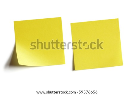 Two yellow sticky note reminders on a white background - stock photo