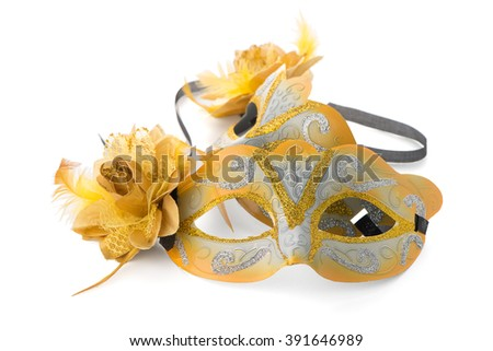 Two yellow venetian masks for a party on a white background