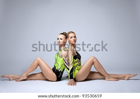 Two young acrobats relax portrait - stock photo